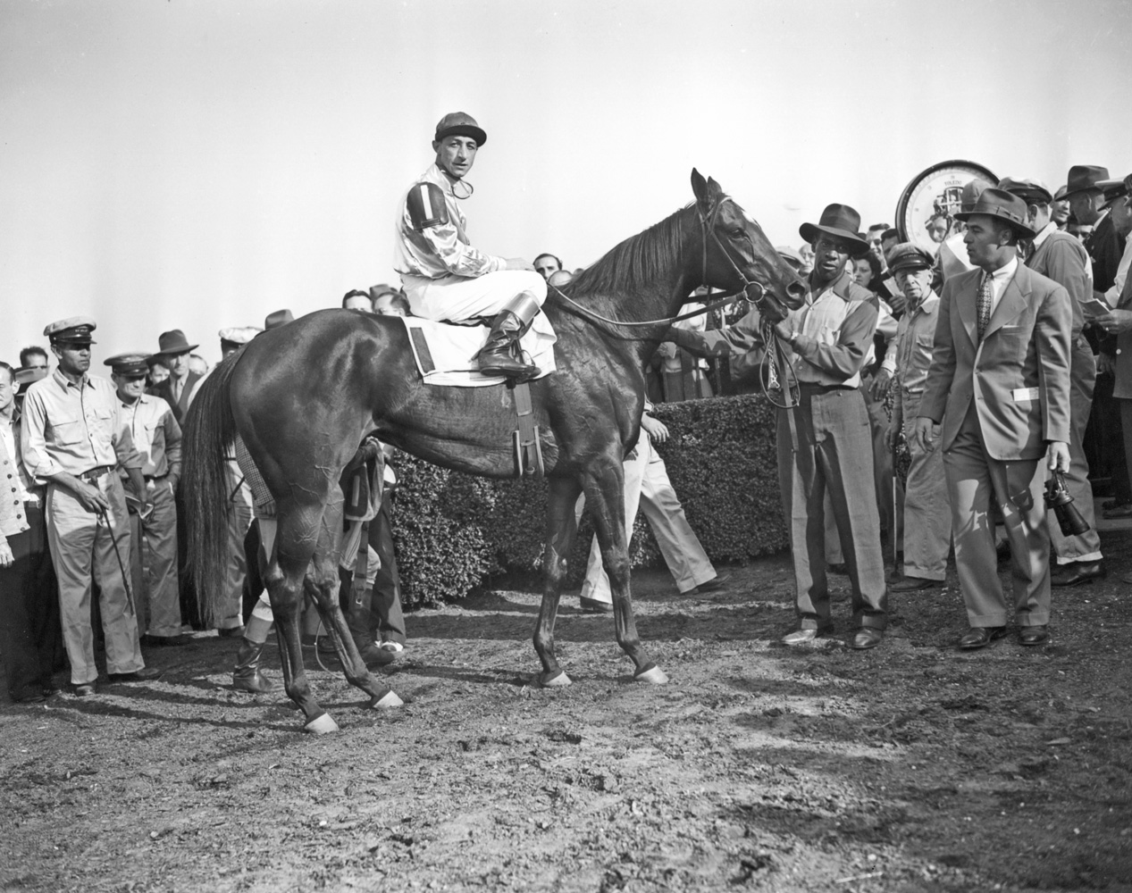 Trainer Sylvester Veitch in the winner's circle with First Flight (Eddie Arcaro up) for the 1946 Belmont Futurity (Keeneland Library Morgan Collection/Museum Collection)