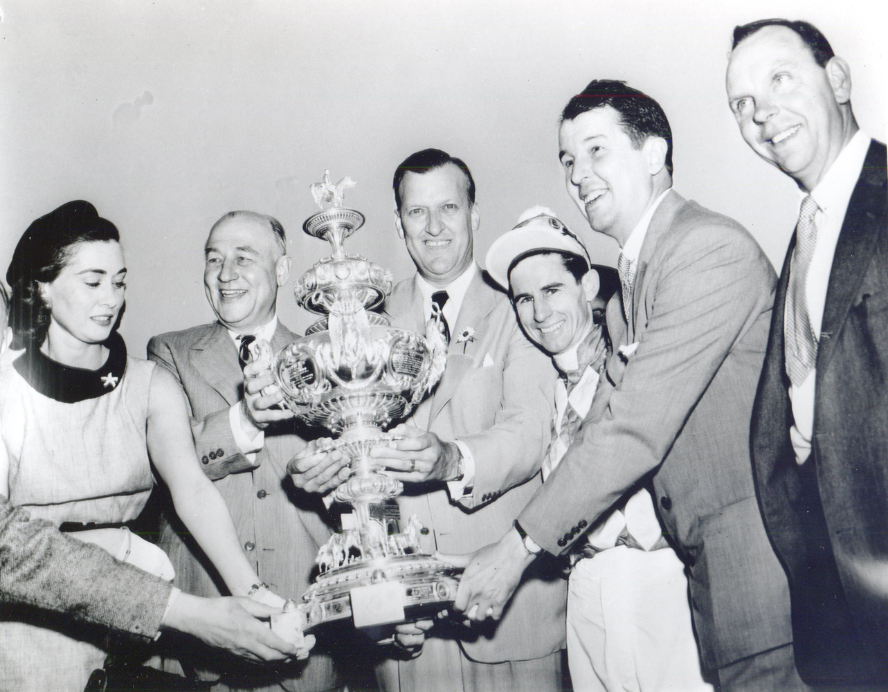 Mr. and Mrs. Alfred G. Vanderbilt, George M. Humphrey, Theodore R. McKeldin, jockey Eric Guerin, and trainer W. C. Winfrey celebrate Native Dancer's win at the 1953 Preakness trophy presentation (Keeneland Library Morgan Collection/Museum Collection)