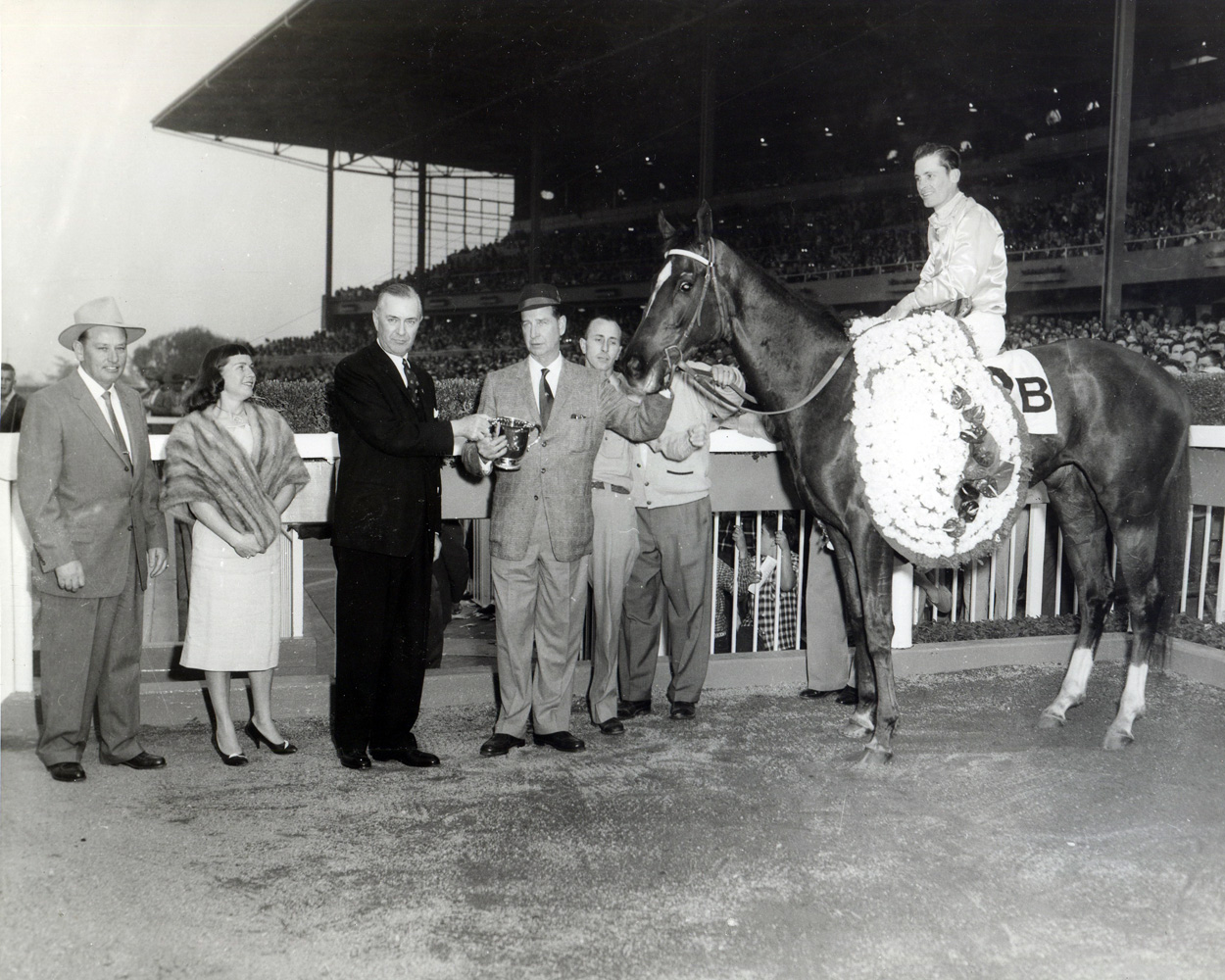 Trainer Robert Wheeler (far left) and owner C. V. Whitney join Silver Spoon (R. York up) in the winner's circle for the 1959 Santa Anita Derby (Museum Collection)