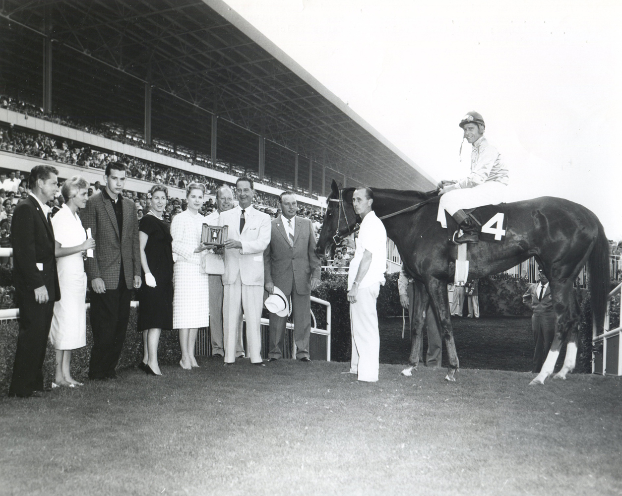 The winning connections of Silver Spoon in the winner's circle for the 1959 Cinema Handicap (Museum Collection)