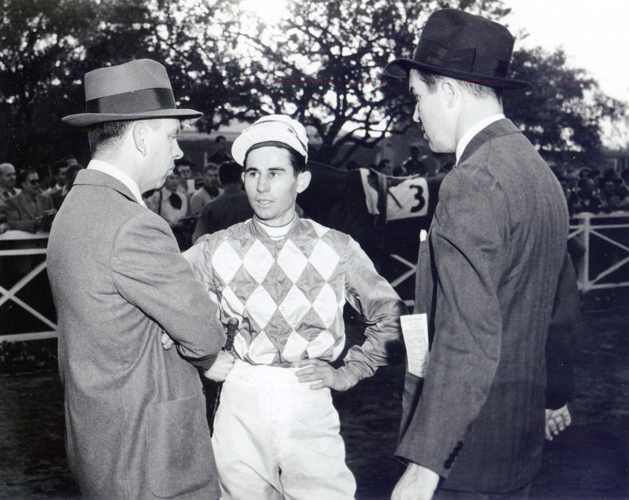 Trainer William C. Winfrey, jockey Eric Guerin, and owner Alfred G. Vanderbilt II in the Santa Anita paddock, circa 1952 (Bill Mochon/Museum Collection)