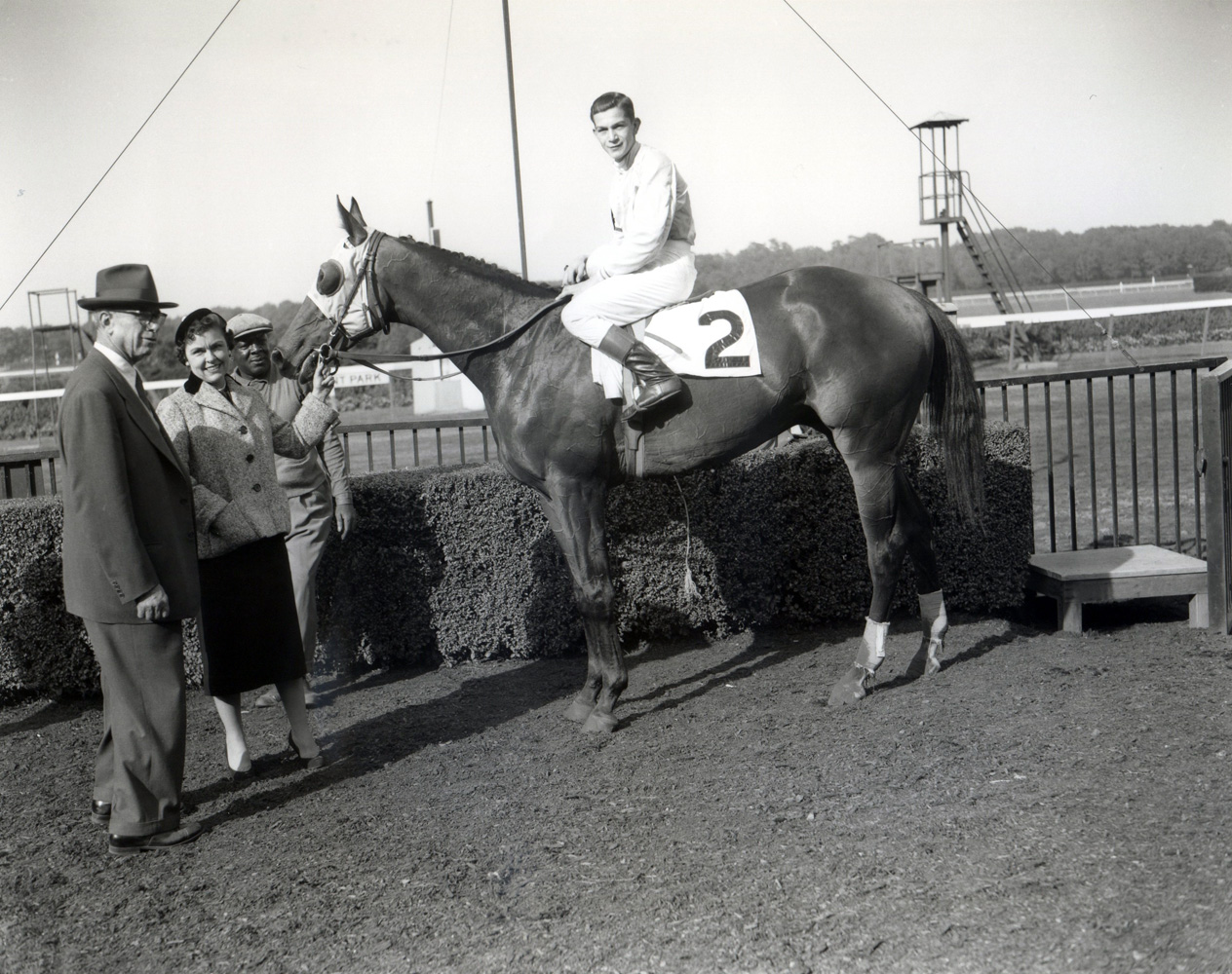 G. Carey Winfrey joining Dedicate (Bill Hartack up) in the winner's circle for the 1957 Woodward Stakes at Belmont Park (Keeneland Library Morgan Collection/Museum Collection)
